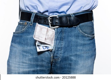 detail of a jean trousers denim with money indise