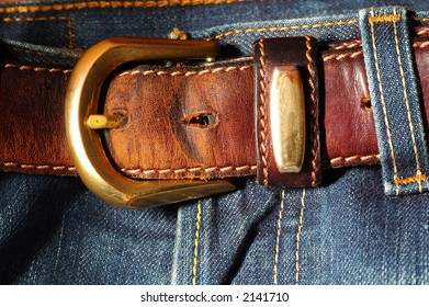 Detail of Jean trousers and leather belt