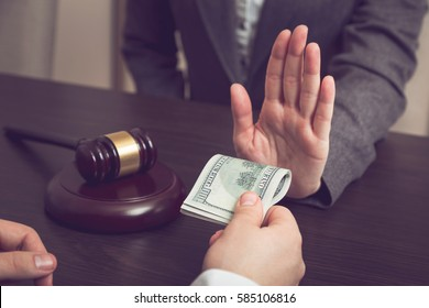 Detail of a judge refusing a bribery money. Selective focus