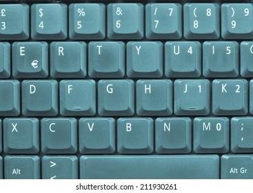 Detail of keys on a computer keyboard - cool cyanotype