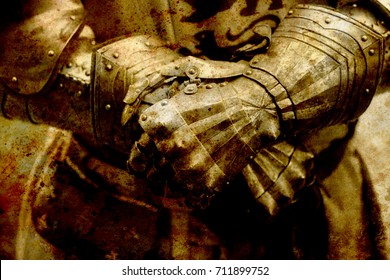 Detail knight armor. Gloves of a knight. Sepia effect.