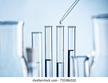 Detail of a laboratory with test tubes, pipette and glass flasks