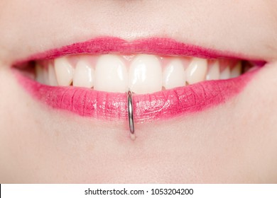 Detail of a Labret Piercing on a Smiling Woman's Mouth