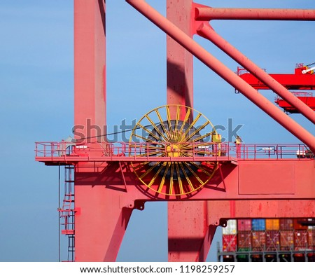 Detail of a large crane used for loading containers on to ships