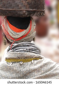 Detail, large necklaces and earrings of a Bonda tribal woman, in Orissa, India