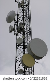 Detail of Large and Small Round UHF Radio Transmitters on a Cell Phone Tower, Alamosa, CO/USA (June 12, 2019)