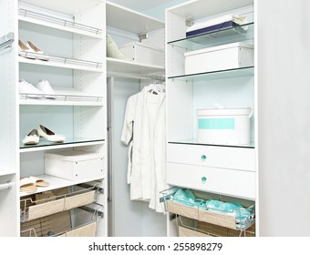 Detail Of Large Walk In Closet With Wardrobe On Hangers