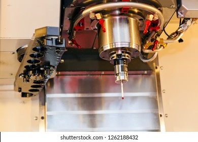 Detail of laser cutting machine head, advanced technology; note shallow depth of field