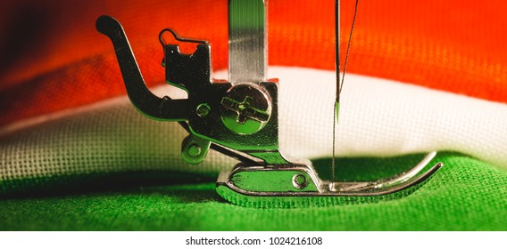 Detail of the leg of a sewing machine, with tricolor cloth of the Italian flag