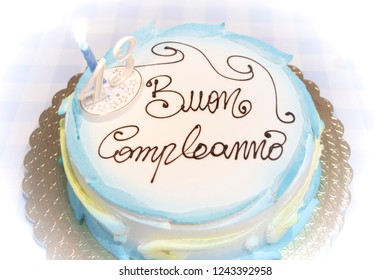 """Detail of lemon cake. Calabrian recipe. Birthday party. Above the cake the writing in Italian """"HAPPY BIRTHDAY"""""""