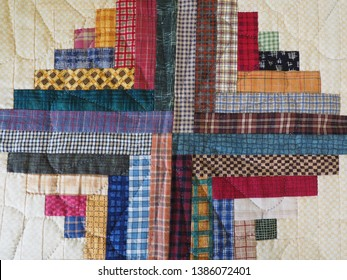 Detail of Log Cabin Quilt Blocks in Plaid Fabric with Hand Quilting