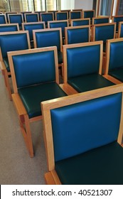 Detail look of rows of chairs in a church