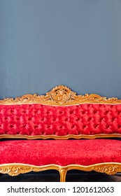 Detail of Luxurious antique red sofa