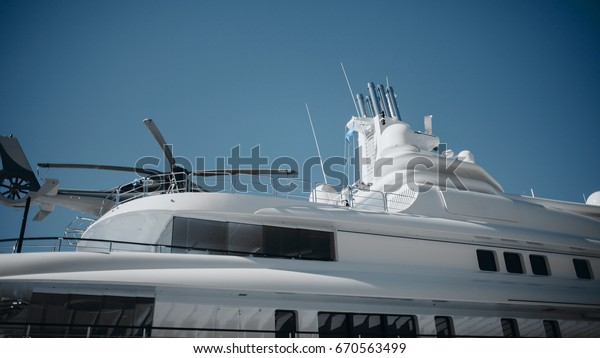 Detail of luxury yacht with helicopter on the top.