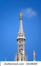 """Detail of the """"Madonnina"""", statue of the  Virgin Mary atop Milan Cathedral (Duomo) in Italy."""
