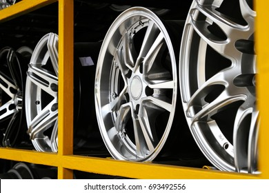 Detail of Magnesium alloy wheel or max wheels of car on shelf in a shop.