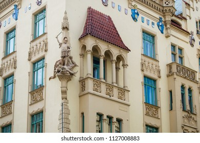 A detail of a magnificent facade of a historic apartment building at Parizska street in Prague - Shutterstock ID 1127008883