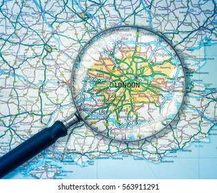 Detail Of A Magnifying Glass Over A Road Map Of London, England