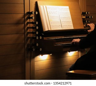 Detail of a man playing a church organ Jeronimos monastery Lisbon, Portugal March 2019