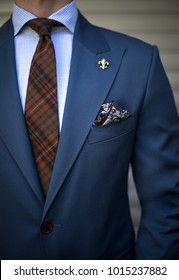 Detail of man in tailored suit pocket square and tie