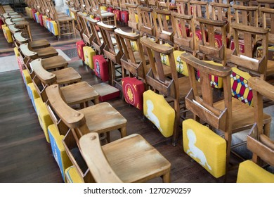 Detail of many church pews with coloured cushions. Wooden seats. concept, religion,faith, god and church