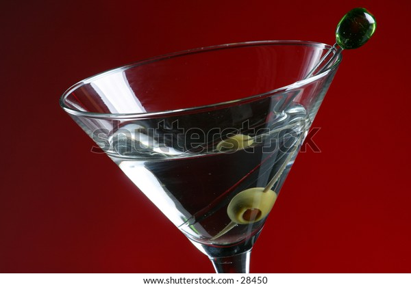 Detail of Martini glass and olive in toothpic