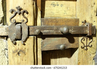 Detail of medieval door of Toledo, Spain, Old metal latch, iron to close heavy wooden door in a street of Toledo