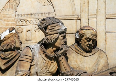 Detail of a medieval relief on the monument to Leonardo Da Vinci in Milan, Italy