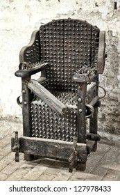detail of medieval torture chair