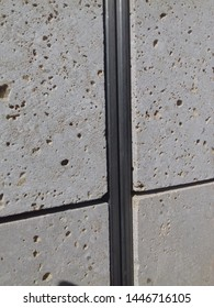 Detail of metal expansion joint with stone