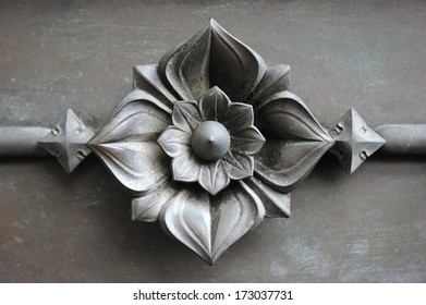 detail of a metal flower art work in wrought iron