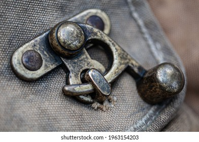 Detail of a metal purse clasp.