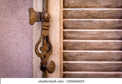 Detail of a metal window fitting. Seen in a village in Provence. It is a typical French fitting to lock the shutters.