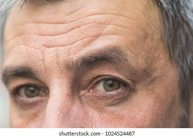 Detail of middle aged man eyes looking at camera.