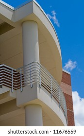 Detail of modern building showing balcony with sky in the background