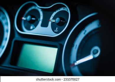 detail of a modern car dashboard with various gauges