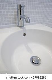 detail of a modern ceramic hand wash basin