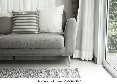 Detail of modern living room with beige pillow cushions on sofa
