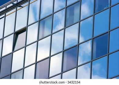 Detail of a modern office building with sky reflection
