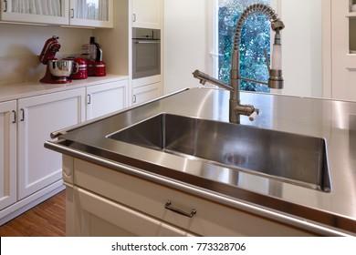 Detail of modern sink in stainless steel