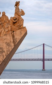 Detail of the Monument to the Discoveries (Padrao dos Descobrimentos) with the 25 of April Bridge on the background in the city of Lisbon, Portugal