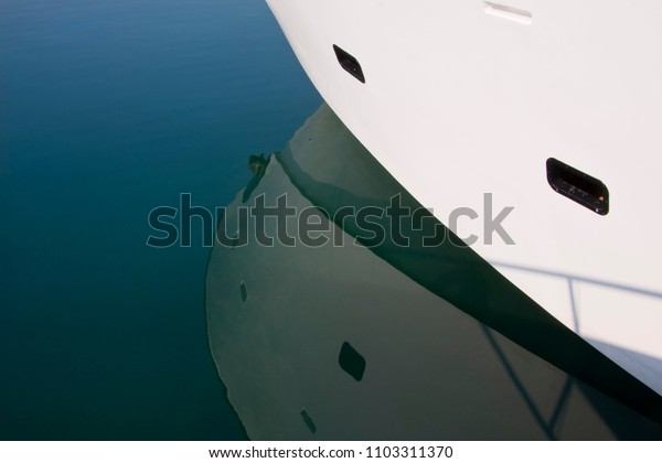detail of a moored yacht on the calm water