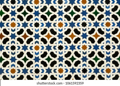 Detail of a mosaic pattern of glazed vintage tiles.