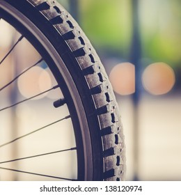 Detail of a Mountain Bike Tire with Four Lights in the Background (vintage style)