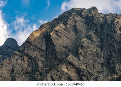 Detail of a mountain rock face. Huge rock wall of granite in High Tatras, Slovakia. High rocky moutain walls.