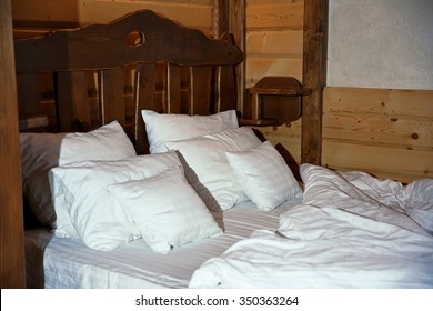 Detail of mountain wooden lodge bedroom