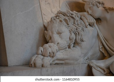 a detail of a mourning lion from the tomb of Marie Christine of Austria, made by the Italian sculptor Antonio Canova.