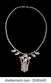 detail of necklace on dark background