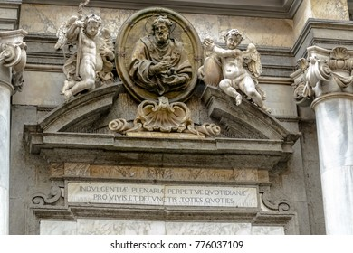Detail of a neoclassic church front representing a Saint and a couple of little angles in the city of Naples, Italy