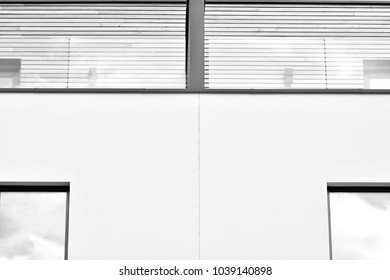 Detail of a new modern apartment building. Black and white.